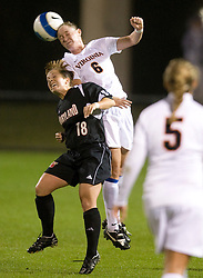 Virginia Cavaliers M Julia Falk (6) wins a header.  The #3 ranked Virginia Cavaliers Women's Soccer team faced the Maryland Terrapins at Klockner Stadium in Charlottesville, VA on October 25, 2007.