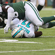 Muhammad Wilkerson, New York Jets, tackles Mike Wallace, Miami Dolphins, during the New York Jets Vs Miami Dolphins  NFL American Football game at MetLife Stadium, East Rutherford, NJ, USA. 1st December 2013. Photo Tim Clayton