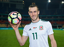 NANNING, CHINA - Thursday, March 22, 2018: Wales' hat-trick hero Gareth Bale with the match-ball after his three goals helped Wales to a 6-0 victory over China during the opening match of the 2018 Gree China Cup International Football Championship between China and Wales at the Guangxi Sports Centre. (Pic by David Rawcliffe/Propaganda)