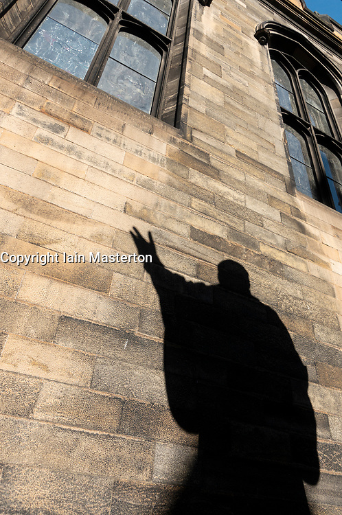 Shadow of statue of John Knox in quadrangle of New College of Edinburgh University, Scotland ,UK