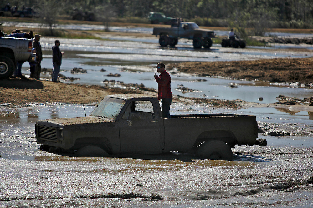 A man tries to get help to unstick his truck at the Redneck Yacht Club in Punta Gorda, Fla. Photo by: Greg Kahn