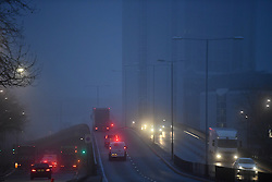 © Licensed to London News Pictures. 30/12/2016. London, UK.   Traffic makes its way through think fog on the A40 flyover in central London at sunrise on another freezing winter morning.. Photo credit: Ben Cawthra/LNP