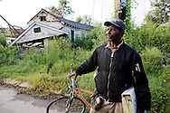 Lower 9th Ward one year after Hurricane Katrina..A resident of the lower 9th, who didn't want to disclose his name, walks through his neighborhood looking for useful items..Much of the lower 9th lay in ruins, city utilities are mostly non-existant..