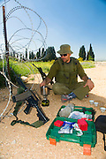 Israel, West Bank, Israeli reserve soldier preparing coffee at leisure during active duty