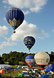 © Licensed to London News Pictures. 10/08/2012. Bristol, UK. Evening balloon mass ascent at the Jones Lang LaSalle Bristol International Balloon Fiesta, which runs from 09-12 August at Ashton Court in Bristol.  This year's fiesta is sponsored by Jones Lang LaSalle. 10 August 2012..Photo credit : Simon Chapman/LNP