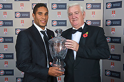 CARDIFF, WALES - Wednesday, November 11, 2009: Wales' Ashley Williams is presented with the Welsh Player of the Year Trophy by FAW President Phil Pritchard during the Football Association of Wales Player of the Year Awards hosted by Brains SA at the Cardiff City Stadium. (Pic by David Rawcliffe/Propaganda)