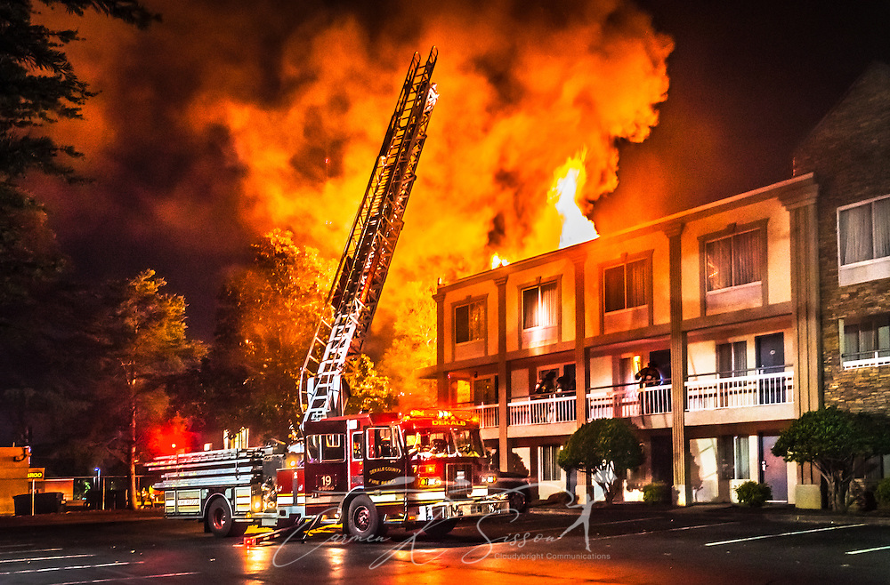 The DeKalb County Fire Department works the scene of a two-alarm fire at Quality Inn on Ranchwood Drive in Tucker, Georgia, June 4, 2014. The fire was reported at approximately 11:30 p.m., and 55 guests were evacuated with no injuries. Several rooms on the third floor were damaged by the fire, which is believed to be suspicious in nature and is currently under investigation. (Photo by Carmen K. Sisson/Cloudybright)