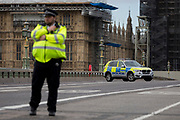 Police block Westminster Bridge as Westminster experiences a lockdown with extensive cordons and the closure of many streets after what police are calling a terrorist incident in which a car was crashed into security barriers outside parliament in central London, on 14th August 2018, in London, England.