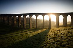 © Licensed to London News Pictures. 23/04/2015. Thornton, West Yorkshire. The sun rises behind Thornton Viaduct as the warm Spring weather continues. Photo credit : Paul Thompson/LNP