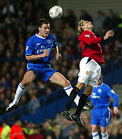 Photograph: Scott Heavey.<br />Chelsea v Manchester United. FA Barclaycard Premiership. 30/11/2003.<br />John Terry out-jumps Diego Forlan
