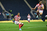 Stoke City midfielder Thomas Ince (7) shoots on goal as Stoke City forward Lee Gregory (19) jumps clear during the EFL Sky Bet Championship match between Preston North End and Stoke City at Deepdale, Preston, England on 21 August 2019.