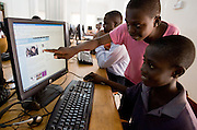 Children browsing the internet at an internet cafe in Accra, Ghana.