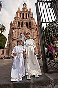Young girls dressed as angels stand in front of the Parroquia de San Miguel Arcangel church at the start of the week long fiesta of the patron saint Saint Michael  September 21, 2017 in San Miguel de Allende, Mexico.
