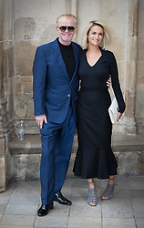 © Licensed to London News Pictures. 27/09/2016.  Chris Evans and Natasha Shishmanian arrive for a Service of Thanksgiving for the Life and Work of Sir Terry Wogan at Westminster Abbey. Veteran broadcaster Sir Terry Wogan died in January 2016. The Irish star had a long and successful career at the BBC, including stints on  radio and TV. London, UK. Photo credit: Peter Macdiarmid/LNP
