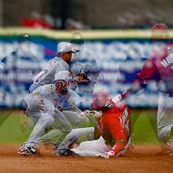 Mar 12, 2013; Clearwater, FL, USA; (editors note: multiple exposure image) Philadelphia Phillies left fielder John Mayberry Jr. (15) is caught stealing by Detroit Tigers shortstop Jhonny Peralta (27) during the bottom of the second inning of a spring training game at Bright House Field. Mandatory Credit: Derick E. Hingle-USA TODAY Sports