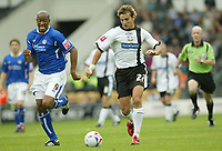Photo: Aidan Ellis.<br /> Derby County v Leicester City. Coca Cola Championship. 01/10/2005.<br /> Leicester's Dion Dublin cant keep with the pace of derby's Inigo Idiakez
