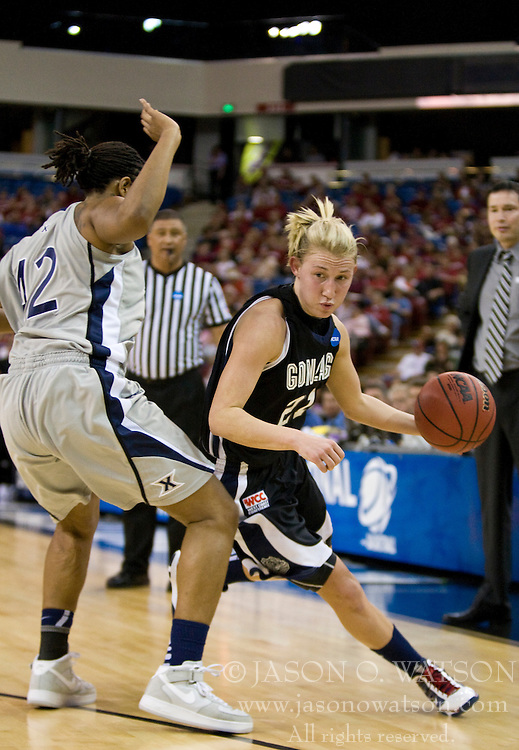 March 27, 2010; Sacramento, CA, USA; Gonzaga Bulldogs guard Courtney Vandersloot (21) dribbles past Xavier Musketeers forward April Phillips (42) during the first half in the semifinals of the Sacramental regional in the 2010 NCAA womens basketball tournament at ARCO Arena. Xavier defeated Gonzaga 74-56.