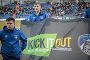 Kick it out banner held on the pitch before the EFL Sky Bet League 1 match between Oldham Athletic and Bury at Boundary Park, Oldham, England on 11 March 2017. Photo by Mark P Doherty.