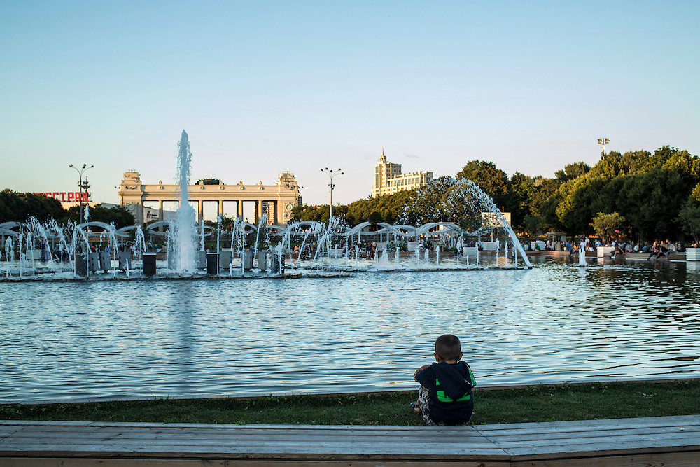 A boy watches the fountain in Gorky Park on Saturday, August 17, 2013 in Moscow, Russia.