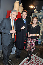 Left to right, ANTONY BEEVOR, NICK FOULKES and MELISSA WYNDHAM at a party to celebrate the publication of Folly de Grandeur: Romance and Revival in an English Country House by Nicky Haslam held at Oka, 155-167 Fulham Road, London on 21st March 2013.