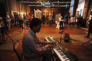 """Bill Perry Jr. plays keyboards at the Yoknapatawpha Arts Council's """"Art For Everyone"""" fundraiser in Oxford, Miss. on Tuesday, October 18, 2011."""