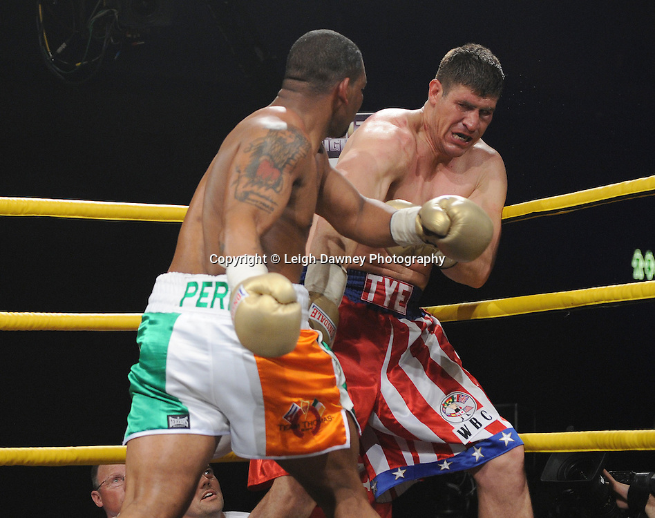 Mike Perez (Irish colour shorts) corners Tye Fields in the final for Prizefighter International on Saturday 7th May 2011. Prizefighter / Matchroom. Photo credit © Leigh Dawney. Alexandra Palace, London.