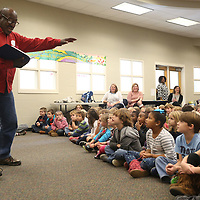 Lauren Wood | Buy at photos.djournal.com<br /> Autry Davis reads poetry aloud and performs for first graders Thursday morning in the library at Saltillo Primary School. Davis performed for the kindergarten, first and second grade students.