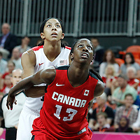 07 August 2012: USA Candace Parker vies for the rebound with Canada Tamara Tatham during 91-48 Team USA victory over Team Canada, during the women's basketball quarter-finals, at the Basketball Arena, in London, Great Britain.