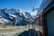 """Breithorn (""""broad horn"""", 4164 m), in the Pennine/Valais Alps, Europe. In Zermatt, the Gornergrat rack railway (GGB) takes you to a spectacular ridge (at 3135 m or 10,285 ft) between Gornergletscher and Findelgletscher, with views of more than twenty 4000-meter-high peaks. Gornergrat train, opened in 1898, climbs almost 1500 m or 4900 ft via Riffelalp and Riffelberg."""