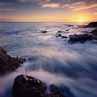Sunset along the western shoreline of Oahu at Kaena Point