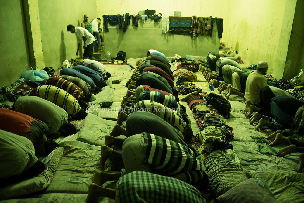 Libya, Zawyia: Migrants pray inside Al Nasr detention center for migrants in Zawyia. Alessio Romenzi
