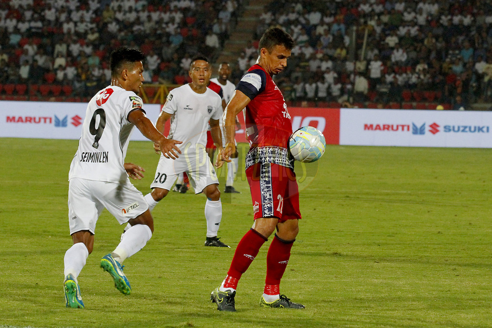Emerson Gomes De Moura of Jamshedpur FC   fight for ball during match 2 of the Hero Indian Super League between NorthEast United FC and Jamshedpur FC held at the Indira Gandhi Athletic Stadium, Guwahati India on the 18th November 2017<br /> <br /> Photo by: Arjun Singh  / ISL / SPORTZPICS