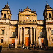 Catedral Metropolitana facing Parque Central (officially the Plaza de la Constitucion) in the center of Guatemala City, Guatemala.