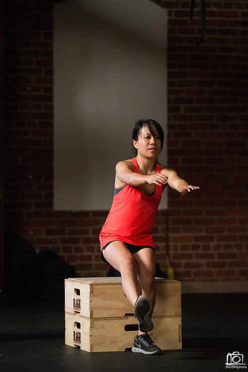 Victoria Hon of San Jose performs one-legged squats during an Introduction to CrossFit program at ThirdSpace Fitness in San Jose, California, on July 6, 2015. (Stan Olszewski/SOSKIphoto for Content Magazine)