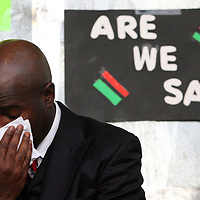 A member of the entourage for the family weeps on stage during the prayer prior to a rally for the shooting of Trayvon Martin on Thursday, March 22, 2012 at Fort Mellon Park in Sanford, Florida. (AP Photo/Alex Menendez) Trayvon Martin rally in Sanford, Florida.
