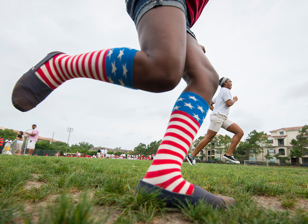 Students run a race during the Memorial Day activities at The Rice School, May 26, 2014.