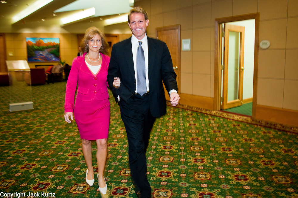 14 FEBRUARY 2011 - PHOENIX, AZ: US Congressman JEFF FLAKE and his wife CHERYL FLAKE walk away from a press conference after announcing that he is running for the US Senate seat being vacated by retiring US Sen. Jon Kyl before Flake's press conference in Phoenix, Monday, Feb.14. Congressman Flake has been in the US House of Representatives since 2001. He is considered a conservative Republican but supports loosening sanctions against Cuba and some form of comprehensive immigration reform. He represents a conservative neighborhood in Mesa, AZ, a suburb of Phoenix.   Photo by Jack Kurtz
