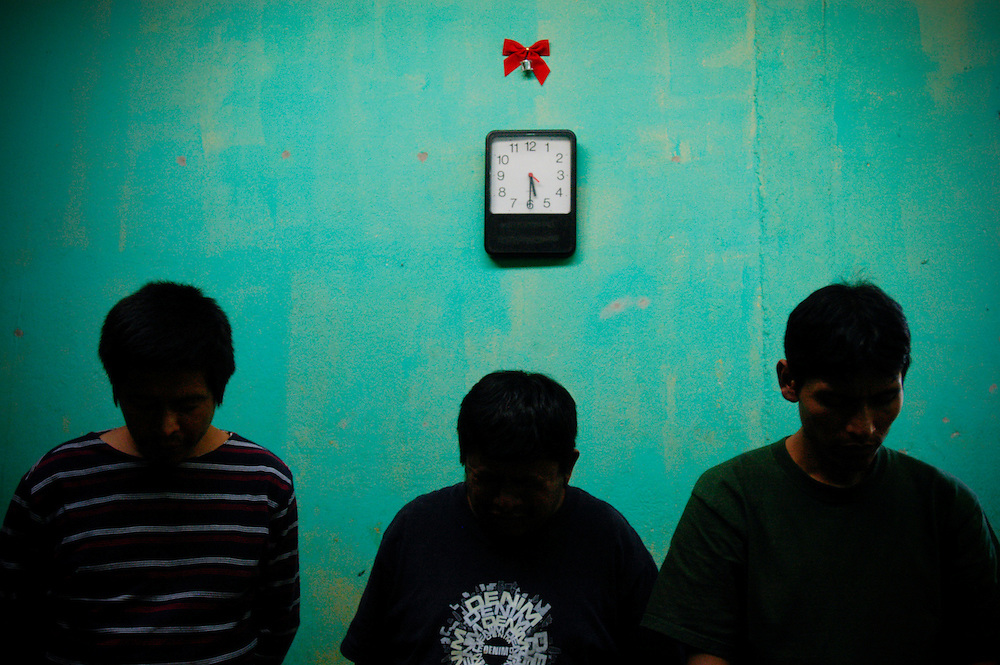 "Three residents of Casa Hogar, a rehabilitation home for alcohol and drug addicts, outside of Antigua, Guatemala,  pray to God Friday, March 23, 2007. Time weighs heavily on the residents and they try to fill every waking hour with something to keep themselves occupied. ""It's so boring being sober,"" says resident Adolpho Fong...Casa Hogar currently houses 44 men (with a maximum of 60.) Jorge Rosales, himself a former drug user, founded the home 2 years ago after he kicked his habit and left the garbage dump he had been living in for thirteen months...If accepted into Casa Hogar the voluntary residents must first spend 6 days in a first floor room of mattresses, are denied showers and must eat meals separately from other residents. Patients in the first floor zone suffer from convulsions, vomiting and other withdrawal symptoms and are monitored round the clock by a nurse. Most alcoholics who enter the program have been drinking rubbing alcohol, according to Rosales, because it is so inexpensive...""If they make it"" says resident Byron Rosales, ""they can join us up top."" It is up to the individual when they feel they are ready to leave the home."