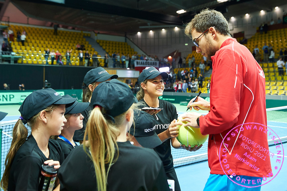Jerzy Janowicz of Poland signs autographs for ball kids during Davis Cup Tie World Group Play-off Poland v Slovakia at Gdynia Arena Hall in Gdynia, Poland.<br /> <br /> Poland, Gdynia, September 20, 2015<br /> <br /> Picture also available in RAW (NEF) or TIFF format on special request.<br /> <br /> For editorial use only. Any commercial or promotional use requires permission.<br /> <br /> Adam Nurkiewicz declares that he has no rights to the image of people at the photographs of his authorship.<br /> <br /> Mandatory credit:<br /> Photo by &copy; Adam Nurkiewicz / Mediasport