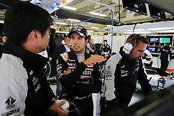 Sergio Perez (MEX) Sahara Force India F1 with Jun Matsuzaki (JPN) Sahara Force India F1 Team Senior Tyre Engineer.<br /> 28.10.2016. Formula 1 World Championship, Rd 19, Mexican Grand Prix, Mexico City, Mexico, Practice Day.<br /> Copyright: Moy / XPB Images / action press