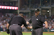 "Major League Baseball umpire Ron Kulpa, left, applies bug spray to umpire Fieldin Culbreth during Game 2 of the 2007 ALDS at Jacobs Field in Cleveland. In what has become known at the ""Bug Game,"" midges infested the infield during the game but seemed to bother the visiting Yankees more than Cleveland."