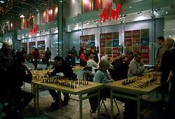 SWEDEN GOTHENBURG JAN04 - Chess players in a shopping mall in Gothenburg.. . jre/Photo by Jiri Rezac. . © Jiri Rezac 2004. . Contact: +44 (0) 7050 110 417. Mobile:  +44 (0) 7801 337 683. Office:  +44 (0) 20 8968 9635. . Email:   jiri@jirirezac.com. Web:    www.jirirezac.com.