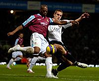 Photo: Ed Godden.<br /> West Ham United v Manchester United. The Barclays Premiership. 17/12/2006. Man Utd's Nemanja Vidic (R), challenges Marlon Harewood.