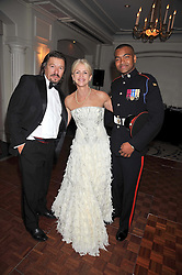 Left to right,  ROBERT LAWRENCE MC, CHARLOTTE STOCKTING and JOHNSON BEHARRY VC at the Matterhorn Challenge Ball in aid of Combat Stress as part of their 90th anniversary celebrations held at The Berkeley Hotel, London on 11th June 2009.