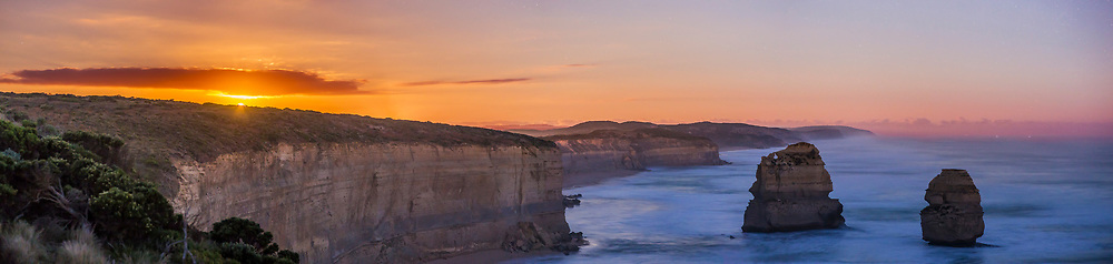 The nearly Full Moon rising over the sea cliffs and sea stacks of the Twelve Apostles formation along the Great Ocean Road near Port Campbell, Victoria, Ausrtralia, on April 12, 2017. This is moonrise, not sunrise &ndash; there are stars in the sky. <br /> <br /> This is a panorama of 4 segments with the 85mm Rokinon lens, stitched with Adobe Camera Raw, each 8 seconds at ISO 1250.