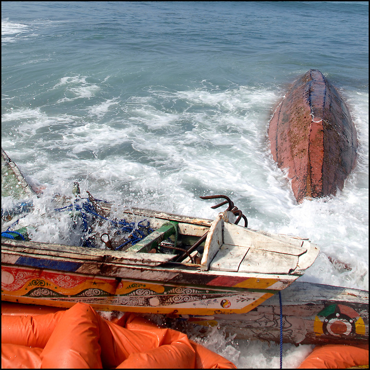 "Tenerife / Los Cristianos June 7, 2006 - A fishing boat called ""Cayucos"" by the inhabitants of the island of Tenerife, is found on the beach after one night of storm. Spanish authorities say the Canary Islands has intercepted more than 7,000 imigrants since January  ."