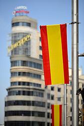 THEMENBILD - Madrid ist seit Jahrhunderten der geographische, politische und kulturelle Mittelpunkt Spaniens (siehe Kastilien) und der Sitz der spanischen Regierung. Hier residieren auch der König, ein katholischer Erzbischof sowie wichtige Verwaltungs- und Militärbehörden. Als Handels- und Finanzzentrum hat die Stadt nationale und internationale Bedeutung. Hier im Bild Edificio Carrion, Hochhaus mit Hotel und Kino, Cine Capito, Capitolgebaeude, royale Beflaggung der Prachtstrasse Calle Gran Via // THEMATIC PACKAGES - Madrid is the capital and largest city of Spain. The population of the city is roughly 3.3 million and the entire population of the Madrid metropolitan area is calculated to be around 6.5 million. It is the third-largest city in the European Union, after London and Berlin, and its metropolitan area is the third-largest in the European Union after London and Paris. The city spans a total of 604.3 km2. EXPA Pictures © 2014, PhotoCredit: EXPA/ Eibner-Pressefoto/ Weber<br /> <br /> *****ATTENTION - OUT of GER*****