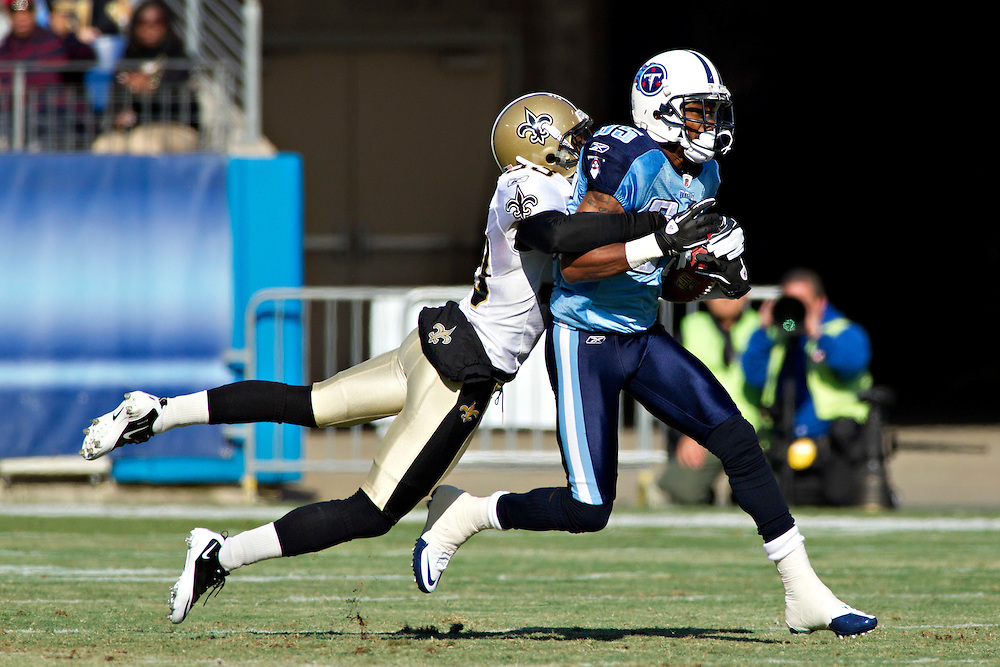 NASHVILLE, TN - DECEMBER 11:   Nate Washington #85 of the Tennessee Titans is tackled by Jabari Greer #33 of the New Orleans Saints at LP Field on December 11, 2011 in Nashville, Tennessee.  The Saints defeated the Titans 22-17.  (Photo by Wesley Hitt/Getty Images) *** Local Caption *** Nate Washington; Jabari Greer