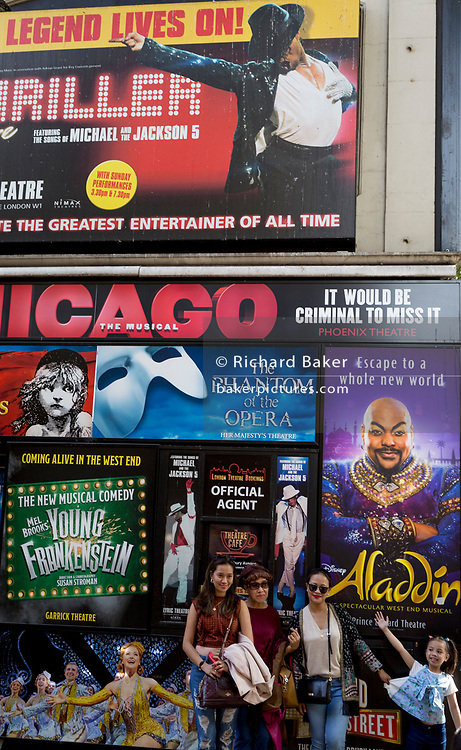 Tourists and London theatreland productions booking office posters, on 15th August 2017, in London, England.