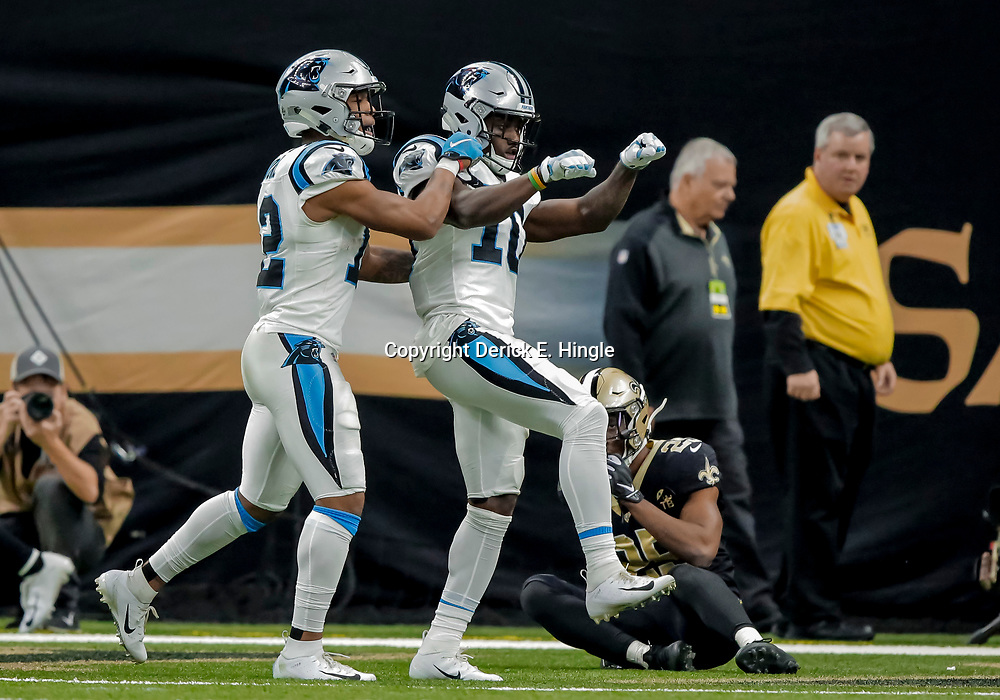 Dec 30, 2018; New Orleans, LA, USA; Carolina Panthers wide receiver Curtis Samuel (10) and wide receiver DJ Moore (12) celebrate after a touchdown during the second half against the New Orleans Saints at the Mercedes-Benz Superdome. Mandatory Credit: Derick E. Hingle-USA TODAY Sports